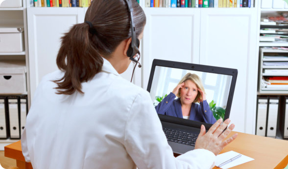 caregiver talking to her patient through online